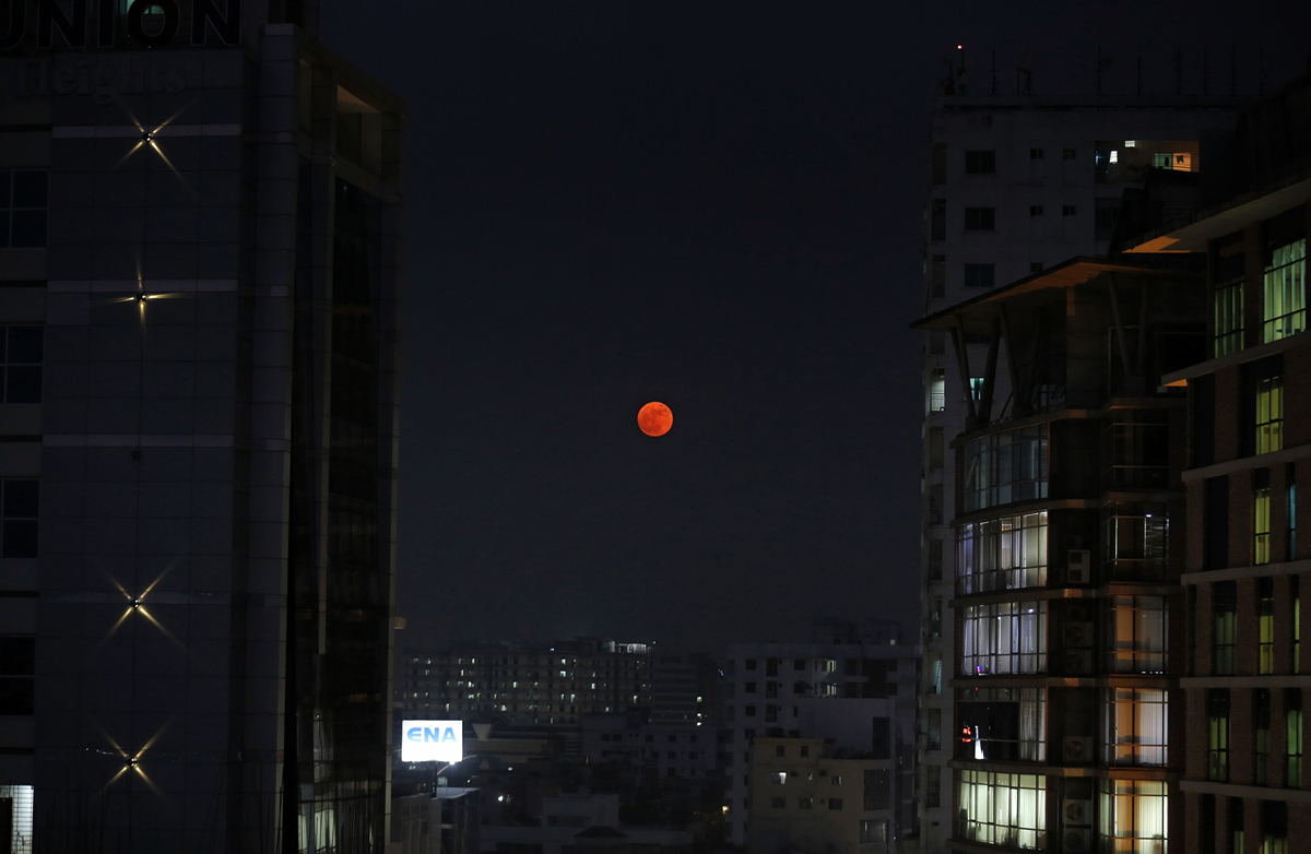 The moon rises above Dhaka, Bangladesh, Monday, Nov. 14, 2016. The brightest moon in almost 69 years will be lighting up the sky this week in a treat for star watchers around the globe. The phenomenon known as the supermoon will reach its most luminescent in North America before dawn on Monday. (AP Photo/ A.M. Ahad)