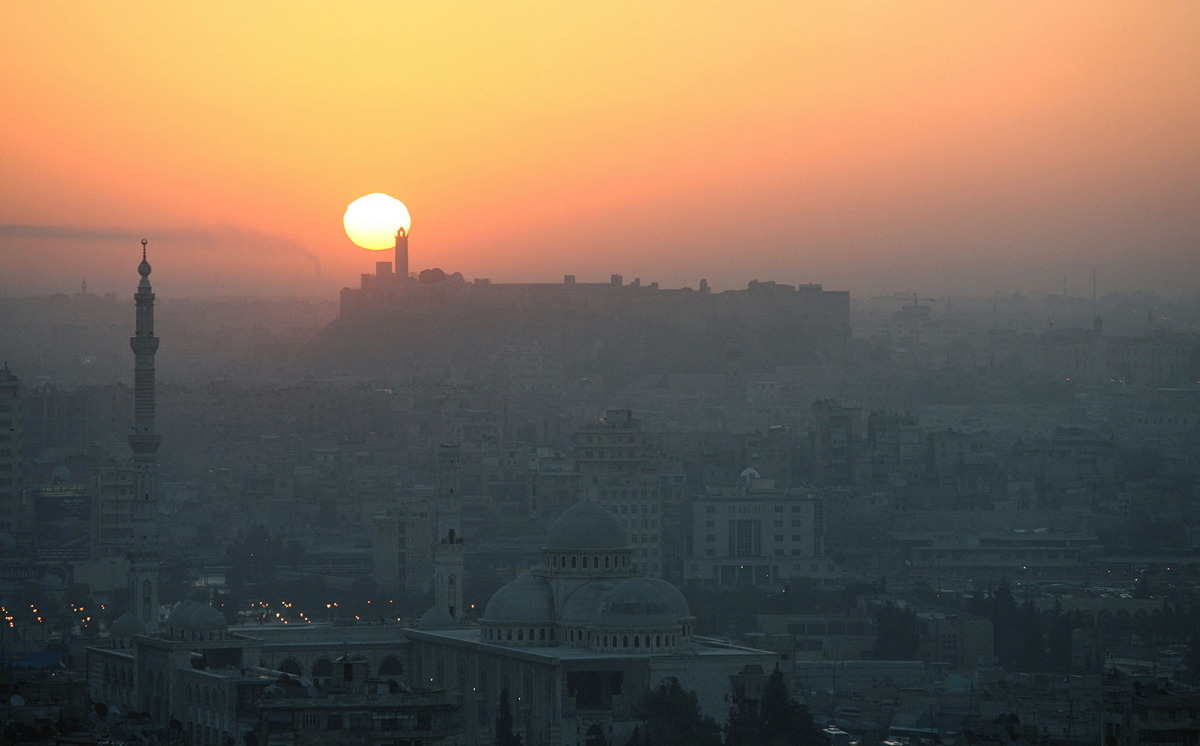 General view of Aleppo in Syria during sunrise March 7, 2006. Aleppo was chosen by the Islamic conference organization in 2004, to become the capital of Arab-Islamic culture on March 18, 2006, after Makkah in 2005. Aleppo, along with Damascus and Sana'a, are the three oldest inhabited cities in human history, and was added to UNESCO's World Heritage List in 1986.   REUTERS/ Khaled al-Hariri - RTR1778G