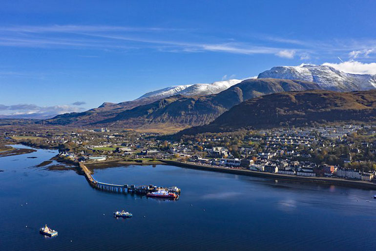 Aerial view of Fort William and snow capped Ben Nevis